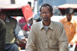 Лица Джайпура: велосипедист в очках