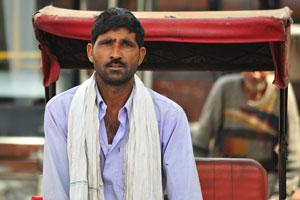 Лица Джайпура: водитель велорикши с шарфом